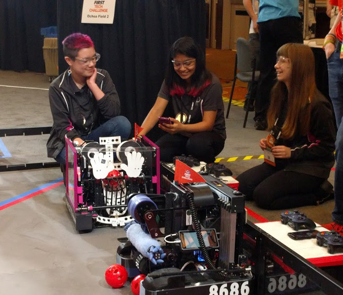 Posse drive team on the field with Stacy the robot