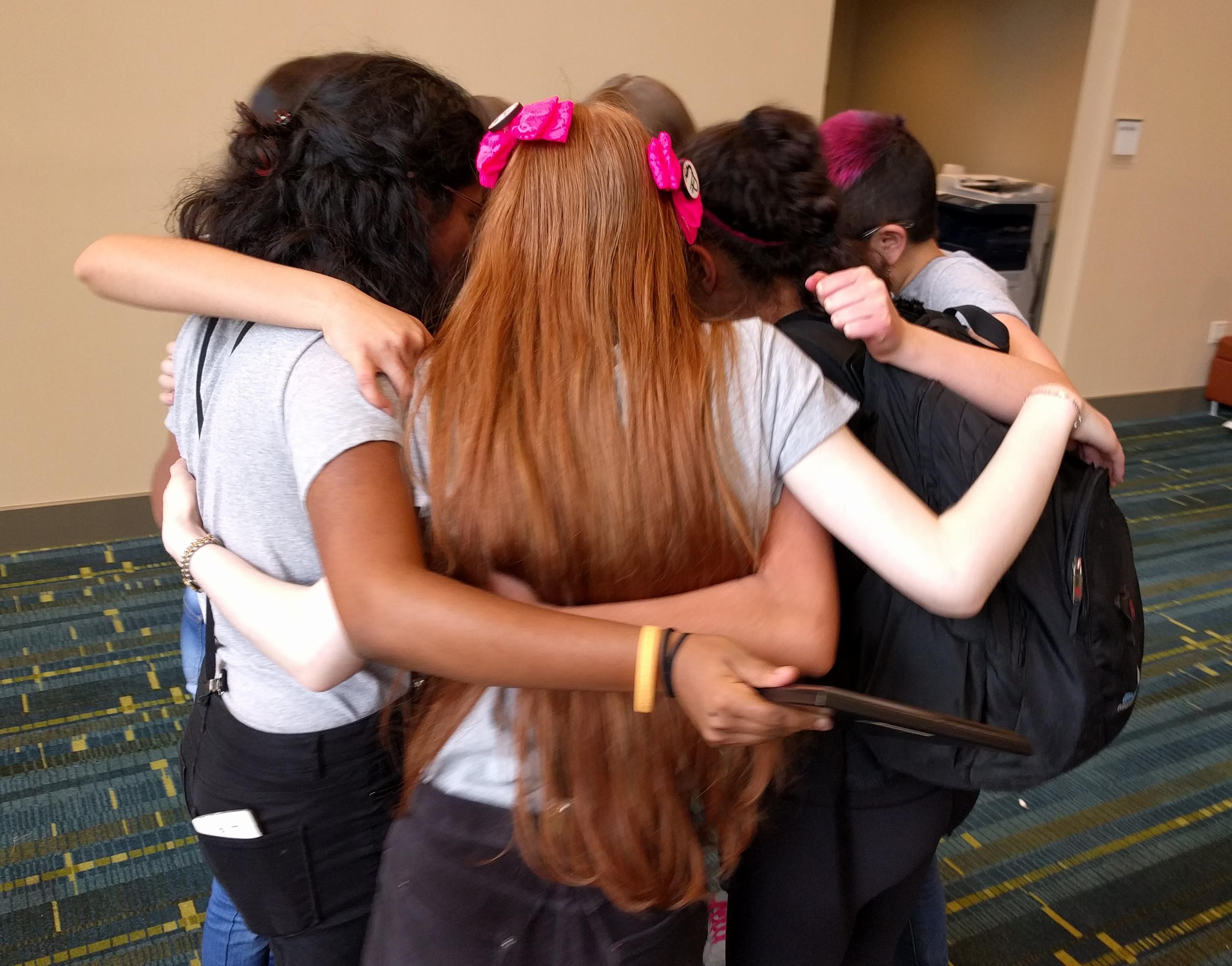 Posse group hug